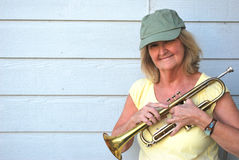 Female trumpet player. Stock Photos