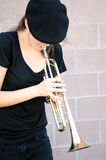 Female trumpet player. Stock Images