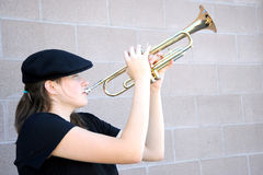 Female trumpet player. Royalty Free Stock Image