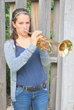 Female trumpet player. Stock Image