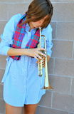 Female trumpet player. Stock Photography