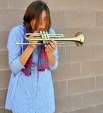 Female trumpet player. Royalty Free Stock Images
