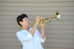 Female trumpet player. Stock Photos