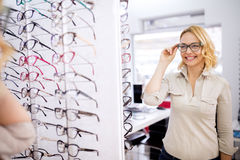 Female try nice frame for eyeglasses Royalty Free Stock Photography