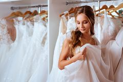 Female trying on wedding dress royalty free stock photos