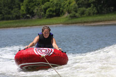 Female tubing. A female tubing in the water stock photos