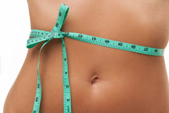 Female tummy with tape measure Royalty Free Stock Images