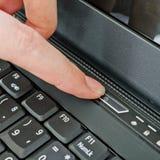 Female turning on a laptop Stock Photo