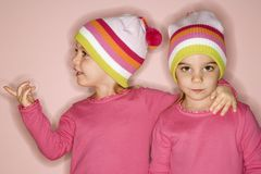 Female twins. Young female twin Caucasian children standing together stock photography