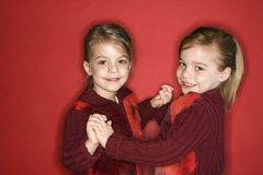 Female twins dancing. Royalty Free Stock Photo