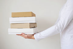 A female two hands hold the empty boxes. Girls hands of delivery holding a box isolated on white Stock Image