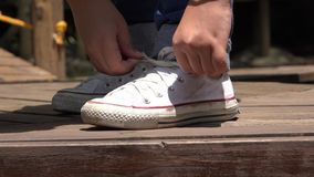 Female Tying White Sneakers stock video