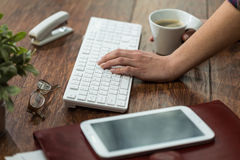 Female typing on keyboard. Close-up of female hand typing on keyboard royalty free stock photos