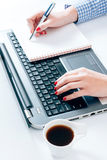 Female typing and writing Stock Photography