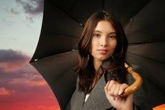 Female with umbrella Stock Image