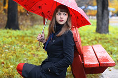 Female with umbrella in the park Stock Photos