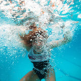 Female underwater with face surrounded by bubbles Royalty Free Stock Image