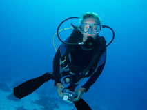 Female underwater photographer. Female scuba diver and underwater photographer Royalty Free Stock Images