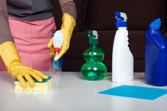 Female in uniform and gloves cleans the table Stock Photography