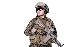 US Marine Soldier. Female United States Marine with rifle weapons in uniforms. Military equipment, army helmet, combat boots, tactical gloves. Women could fight Stock Photography