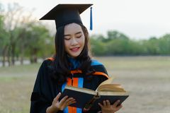 Female university student graduation commencement royalty free stock image
