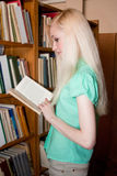 Female university student read book in the library Royalty Free Stock Image