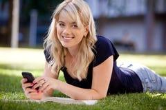 Female University Student Sending Text Stock Images