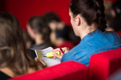 Female university student sitting in class Royalty Free Stock Photos