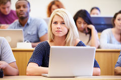 Female University Student Using Laptop In Lecture Royalty Free Stock Photos