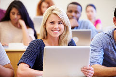 Female University Student Using Laptop In Lecture Stock Images
