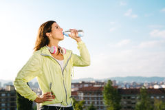 Female urban athlete  drinking water Royalty Free Stock Photo