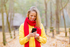Female using cellphone outdoors Stock Photography