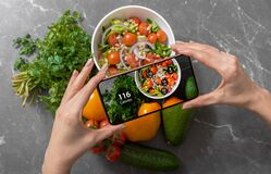 Female using dieting app on a smartphone