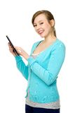 Female using digital tablet Royalty Free Stock Image