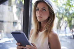 Female using her portable digital tablet for remote job during recreation time Stock Images