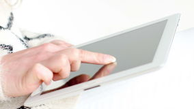 Female Using Her Touchpad. While Sitting on Couch stock footage
