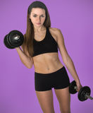 Female Using Iron Hand Weights Stock Photography