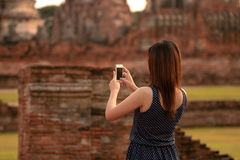 Female using smartphone at sight seeing place Royalty Free Stock Images
