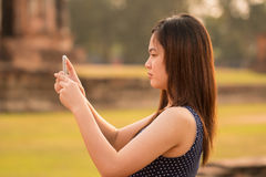 Female using smartphone at sight seeing place Stock Photos