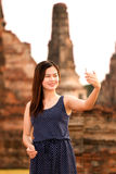 Female using smartphone at sight seeing place Royalty Free Stock Photography