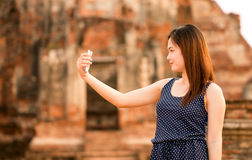 Female using smartphone at sight seeing place Stock Images
