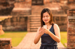 Female using smartphone at sight seeing place Stock Photography