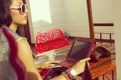 Female Using Tablet Computer in Sunlight Royalty Free Stock Photo