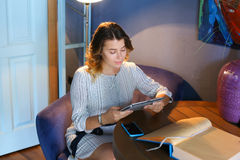Female using technology in cafe phone tablet Royalty Free Stock Photography