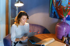 Female using technology in cafe phone tablet Stock Photo