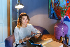 Female using technology in cafe phone tablet Royalty Free Stock Photo