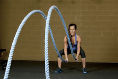 Female Using Training Ropes Royalty Free Stock Photo