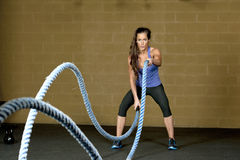 Female Using Training Ropes Stock Image