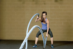 Female Using Training Ropes Stock Images
