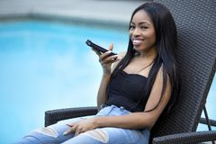 Female on a Vacation using a Voice Assistant on a Smart Phone Stock Photo
